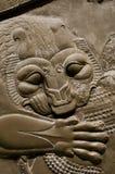 Détail d'un soulagement persan antique montrant la tête d'un lion Photographie stock libre de droits