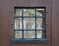 Détail d'une fenêtre avec des barres, rétro Image stock