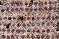 Détail de brique multicolore au site excavé à Pompeii, Italie photographie stock libre de droits