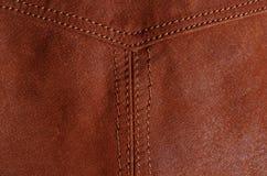 Détail de couture dans la veste en cuir brune Photo stock