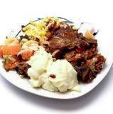 Détail de plan rapproché de repas de boeuf de rôti avec des légumes Photo libre de droits