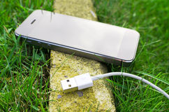 Détail de téléphone avec le câble Image stock
