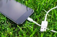 Détail de téléphone avec le câble Image libre de droits