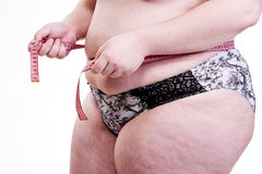 Détail du tronc d'une fille avec l'obésité Image stock