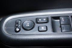 Détail sur des boutons commandant les fenêtres Image stock