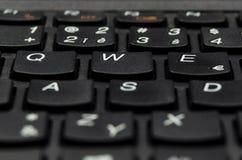 Détaillez la vue de plan rapproché des lettres noires de clé de clavier Photographie stock libre de droits