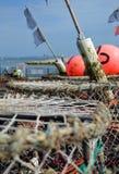 Détaillez la vue des pots de la balise et de homard du pêcheur Image stock