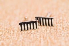 Détails noirs de boutons de manchette Photographie stock libre de droits