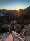 Détente à un coucher de soleil Image stock