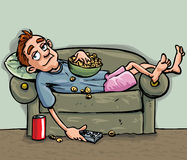 Détente de l'adolescence de dessin animé sur le sofa Photos libres de droits