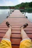 Détente par le lac Images libres de droits