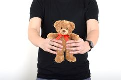 Dê a homens da peluche do urso o fundo do branco do menino do homem Imagens de Stock Royalty Free