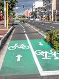 Dê um ciclo pistas para bicicletas na rua do cais, Auckland, Nova Zelândia, imagem de stock