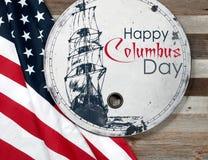 Día de Colón feliz Estados Unidos señalan por medio de una bandera fotos de archivo libres de regalías