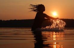 Día de fiesta de la puesta del sol en el lago Imágenes de archivo libres de regalías