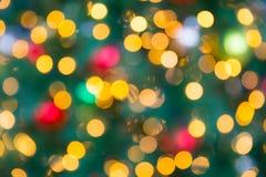 Día de fiesta ligero del Año Nuevo de Bokeh de la falta de definición de la Navidad Fotografía de archivo libre de regalías