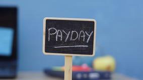 Día de paga escrito imagen de archivo