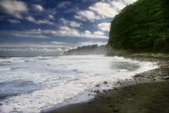 Día de playa negra de la arena Fotos de archivo libres de regalías