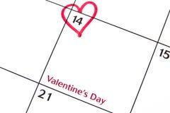 Día de tarjeta del día de San Valentín en un calendario Imágenes de archivo libres de regalías