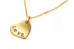 Día de tarjetas del día de San Valentín pendiente del corazón del oro Imagenes de archivo