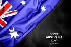 Día feliz de Australia - 26 de enero Bandera australiana en fondo oscuro fotografía de archivo