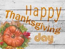Día feliz de la acción de gracias con la calabaza y las hojas de otoño en blanco Imágenes de archivo libres de regalías