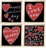 Día feliz de la tarjeta del día de San Valentín s en la pizarra Imagen de archivo libre de regalías