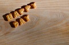 Día feliz Letras comestibles Imagenes de archivo