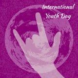 Día internacional de la juventud 12 August Sign de los cuernos Tierra del planeta Fondo carmesí del grunge Imágenes de archivo libres de regalías
