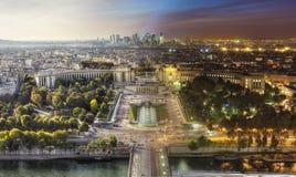 Día a la opinión de la noche de París de la torre Eiffel Imagenes de archivo