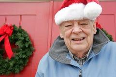 Días de fiesta de la Navidad del hombre mayor Foto de archivo libre de regalías