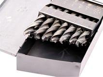 Dígitos binarios de taladro en un rectángulo del metal Foto de archivo