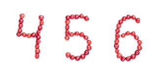 Dígitos da cereja isolados foto de stock
