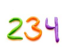 Dígitos da massa de modelar (sinais, letras) fotos de stock