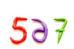 Dígitos da massa de modelar (sinais, letras) fotos de stock royalty free