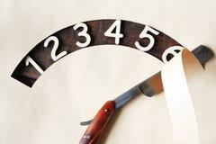 Dígitos e lâmina imagens de stock