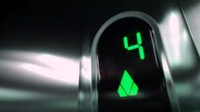 Dígitos verdes do elevador video estoque