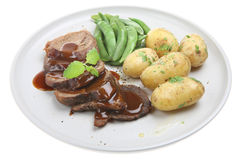 Dîner d'agneau avec les pommes de terre de primeurs photos stock