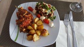 dîner dans le Grec Photographie stock libre de droits