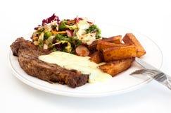 Dîner de bifteck avec des fritures Image stock