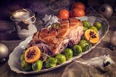 Dîner de Noël avec des choux de bruxelles en sauce orange Photographie stock