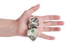 Dólar amarrotado em seu mão um homem idoso Imagem de Stock