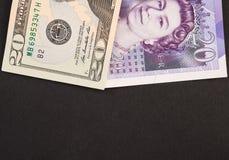 Dólar americano e cédulas inglesas da libra imagem de stock