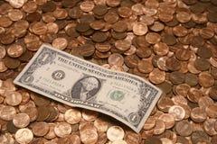 Dólar & moedas de um centavo Foto de Stock