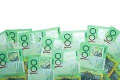 Dólar australiano, dinero de Australia 100 dólares de pila de los billetes de banco en el fondo blanco Imagenes de archivo