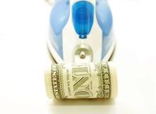 Dólar bajo el hierro Imágenes de archivo libres de regalías