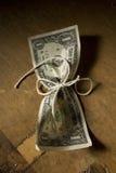 Dólar Bill atado en cadena Fotografía de archivo