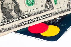 Dólar de EE. UU. con la tarjeta de crédito Imágenes de archivo libres de regalías