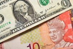 Dólar de EE. UU. y ringgit Malasia Imagen de archivo libre de regalías
