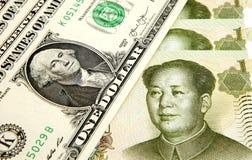 Dólar de EE. UU. y yuan chino Imagen de archivo